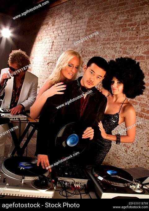 Handsome Asian DJ at a 1970s Disco Music Party