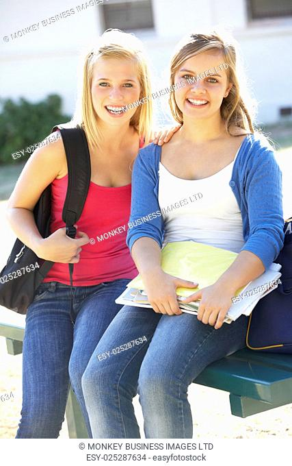 Two Female Students Outside College Building