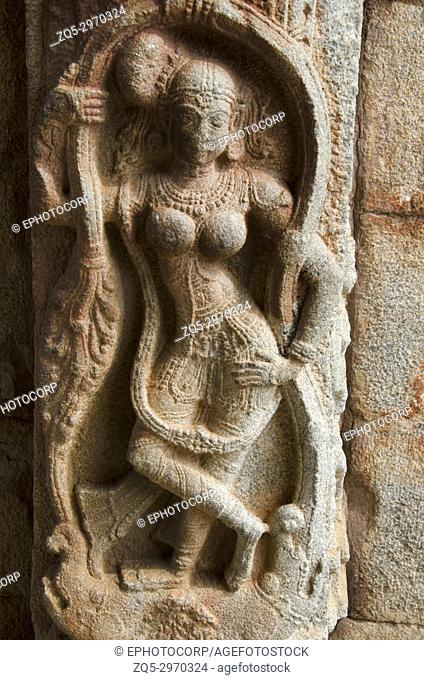 Carving details on the outer wall of entrance gate, Vittala Temple Complex, Hampi, Karnataka, India. Built in 15th century