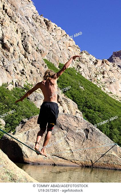 Slacklining, tightrope walking or funambulism at Frey shelter in Bariloche, Patagonia, Argentina