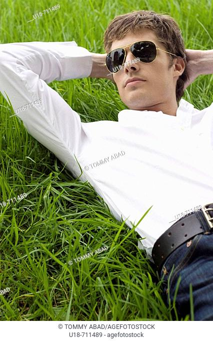 a man laying down on the grass
