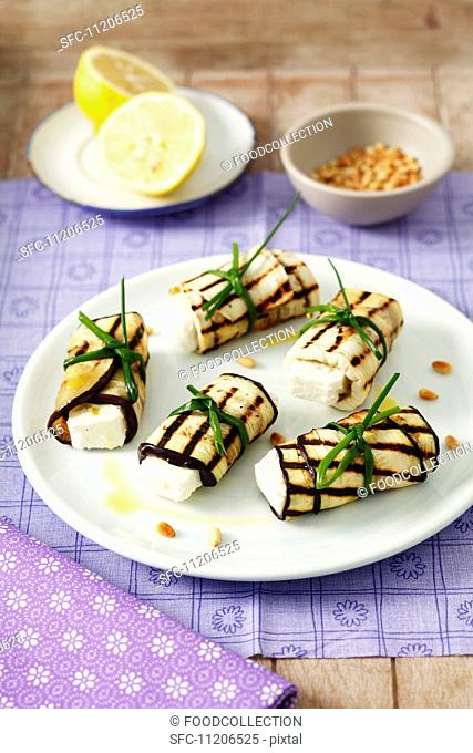 Rolled aubergine slices stuffed with feta
