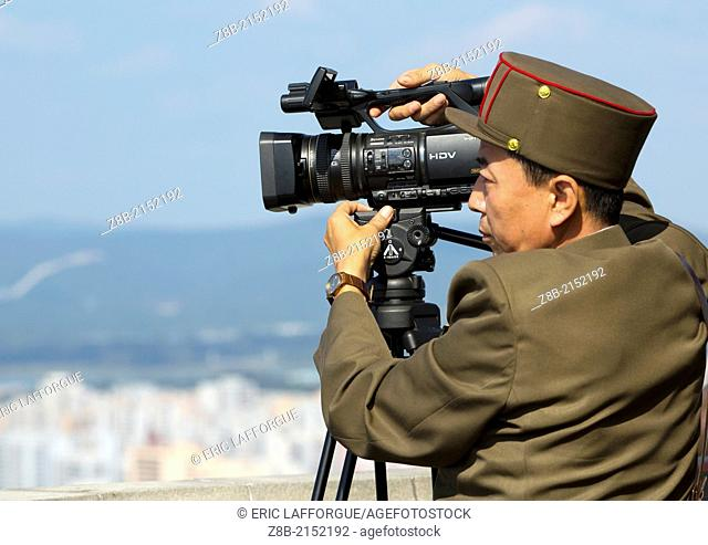 North Korean Soldier Filming Pyongyang City From The Juche Tower, Pyongyang, North Korea