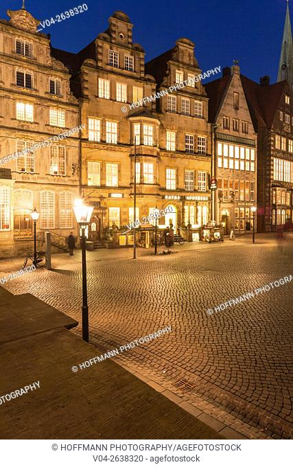 Illuminated historic houses in the evening at the market square in Bremen, Germany, Europe