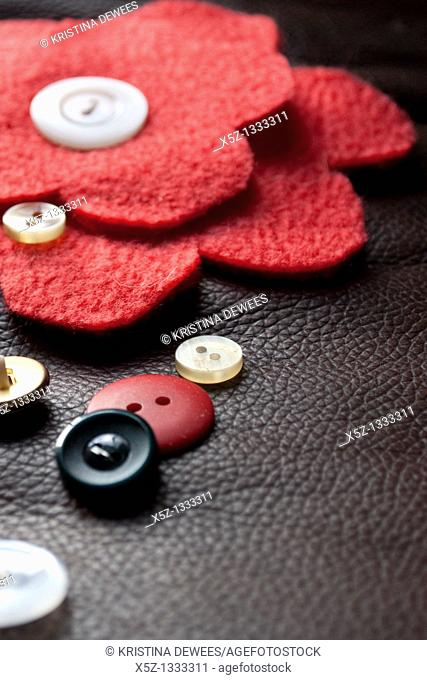 A red fleece flower with button center and miscellaneous buttons