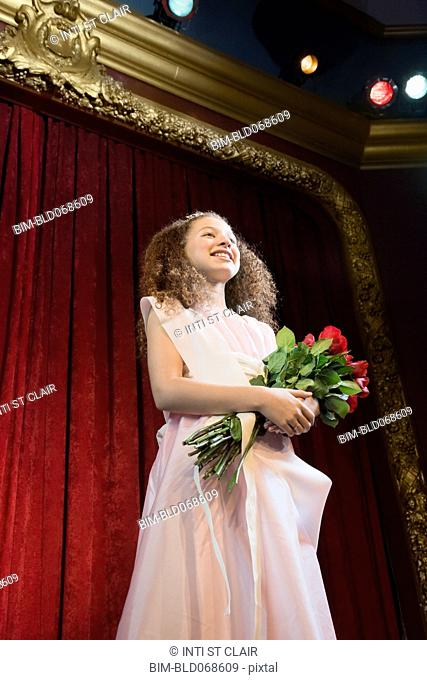 Mixed race girl competing in beauty pageant