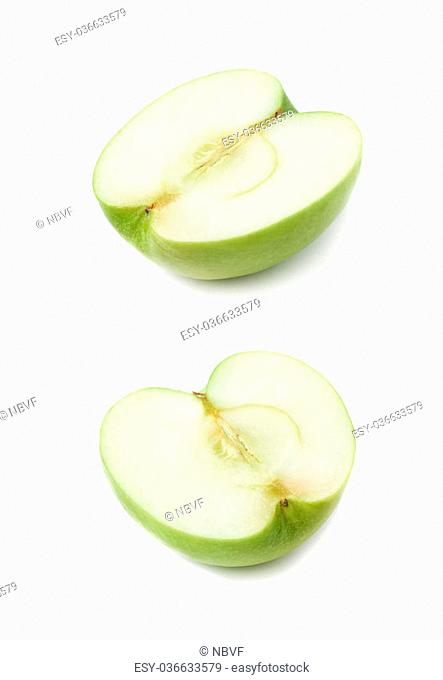 Sliced half of a green apple isolated over the white background, set of two different foreshortenings