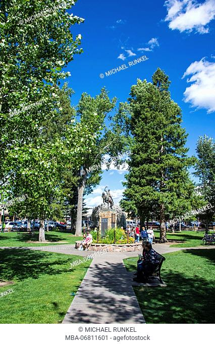 Cowboy monument in a park in the center of Jackson Hole, Wyoming, USA