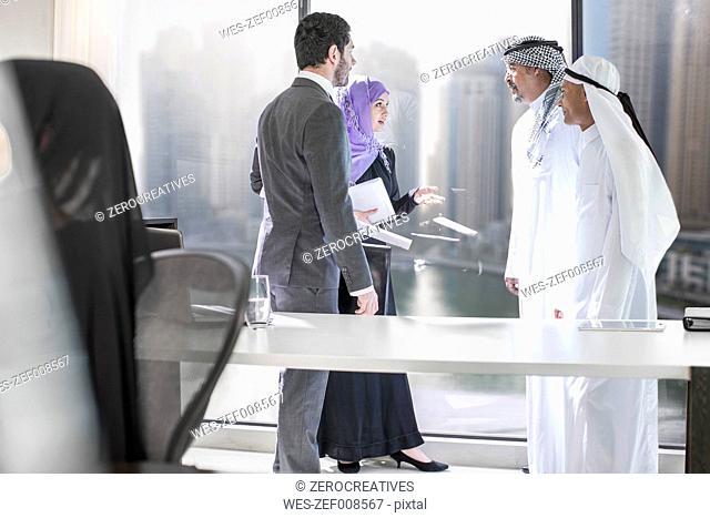 Western businessman meeting Middle Eastern businessmen
