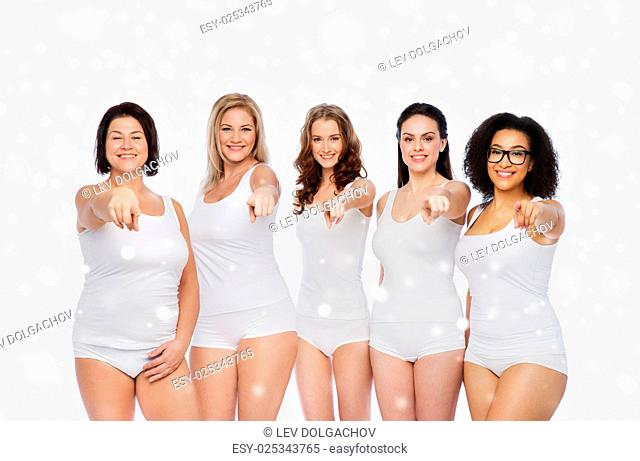 choice, friendship, beauty, body positive and people concept - group of happy different women in white underwear pointing finger on you over snow