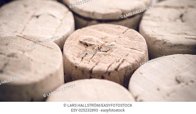 Wine cork detail. A group of wine corks in close-up. Concept of drinking or making wine. Symbol of winery or alcohol drinks