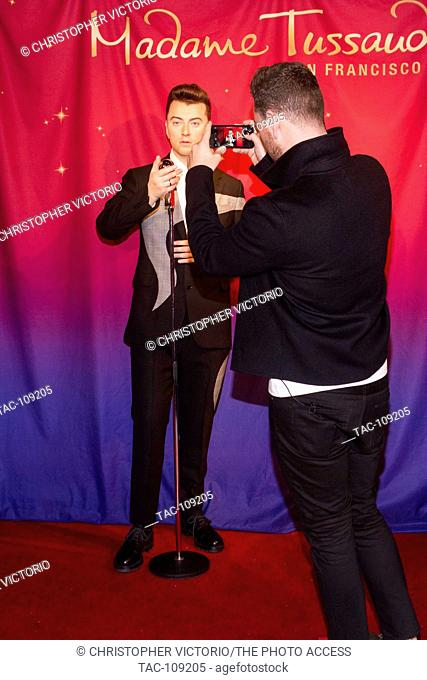 SAN FRANCISCO, CA- AUG 10: Musician Sam Smith appears next to the premier of a life-like statue of himself at Madame Tussauds on August 10