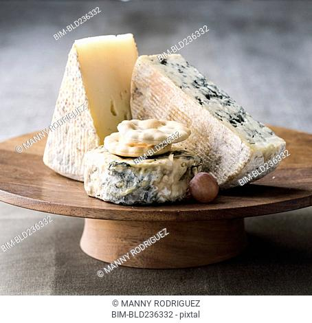 Wedges of cheese on tray