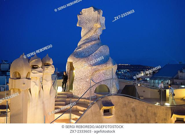 Casa Mila, La Pedrera, skyline of Barcelona, Spain. The chimneys. Panorama of the roof at dusk, evening, night. Unesco Heritage