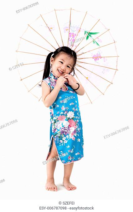 Little oriental girl in traditional Chinese dress cheongsam with umbrella