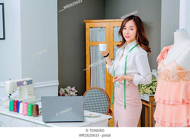 Smiling female fashion designer