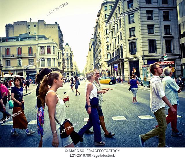 Green light, people crossing a street. Via Laietana, Barcelona, Catalonia, Spain