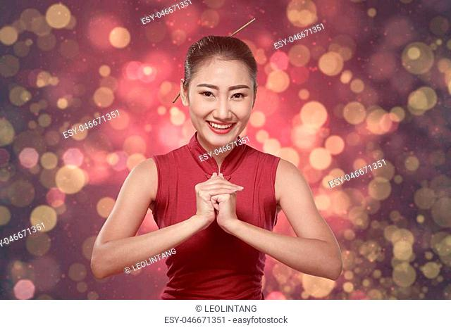 Chinese woman in cheongsam dress. Happy chinese new year concept