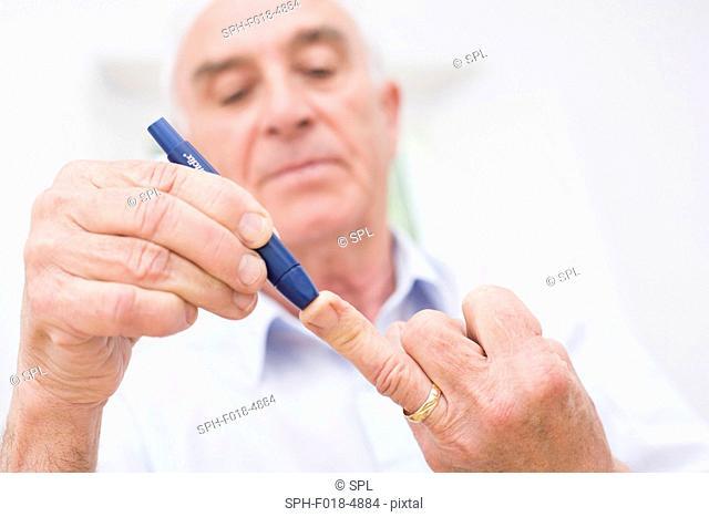 Man doing finger prick test for blood glucose