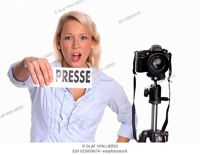 vigorously press photographer with a camera holding a press badge