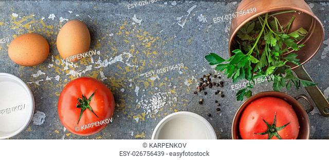 Ingredients for backed eggs with tomatoes wide screen