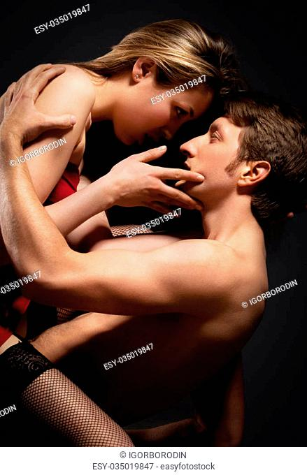Sexy young couple kissing. Low Key photo