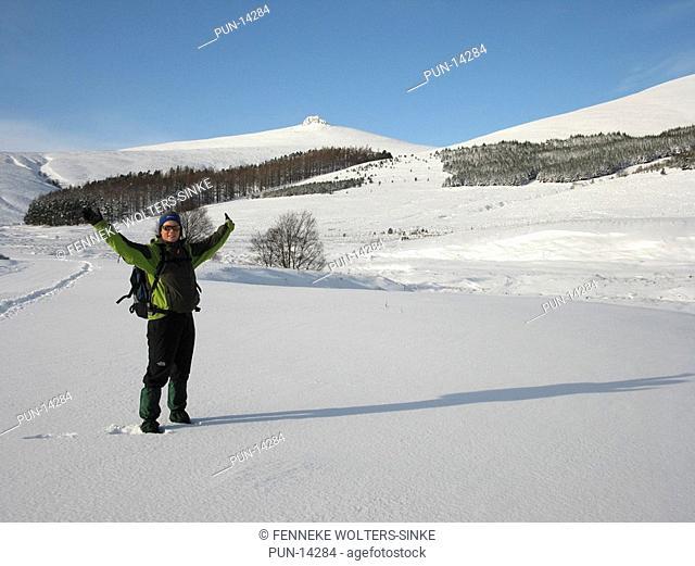 Walker at Clachnaben, Aberdeenshire, Scotland, in winter