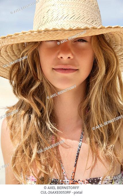 Pretty women in straw hat in the sun