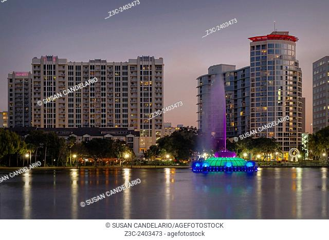 Lake Eola Memorial Water Fountain - The multi color and illuminated Linton E. Allen Memorial Water Fountain during twilight along with the downtown Orlando...