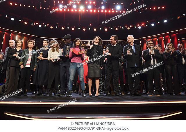 24 February 2018, Germany, Berlin, Award Ceremony, Berlinale Palace: The award winners pose on stage together after the ceremony