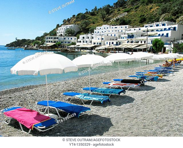 Sunbeds and Umbrellas on the beach, Loutro, South Crete, Greece