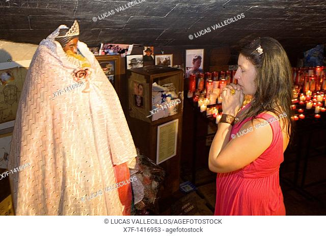 Pilgrim praying to Sainte Sara in in the Crypt of chuch Annual gipsy pilgrimage at Les Saintes Maries de la Mer may,Camargue, Bouches du Rhone, France