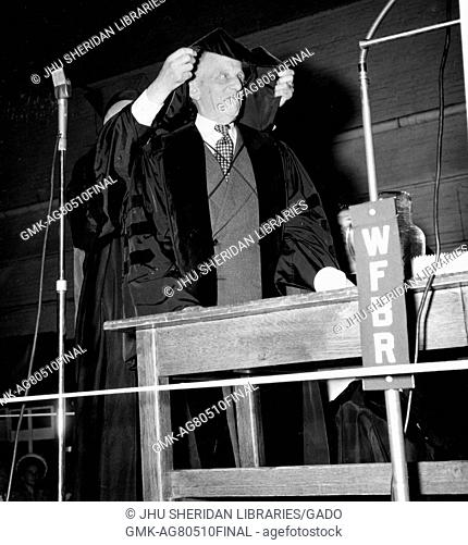 Candid portrait of American mathematician Luther Pfahler Eisenhart receiving an honorary degree hood at the Johns Hopkins University in Baltimore, Maryland