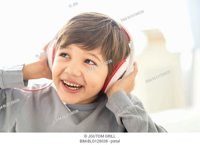 Hispanic boy listening to headphones
