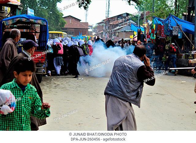 tear gas shell explodes near Kashmiri students protesting, Kashmir, India, Asia