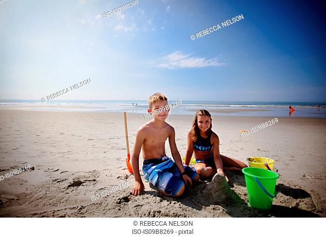 Siblings playing on beach
