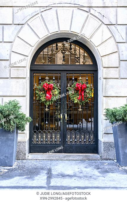 Manhattan, NYC. Apartment Building Entrance Decorated with Holiday Wreaths