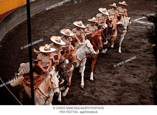 Escaramuzas ride their horses before competing in an Escaramuza competition in the Lienzo Charros del Pedregal, Mexico City, Sunday, March16, 2013
