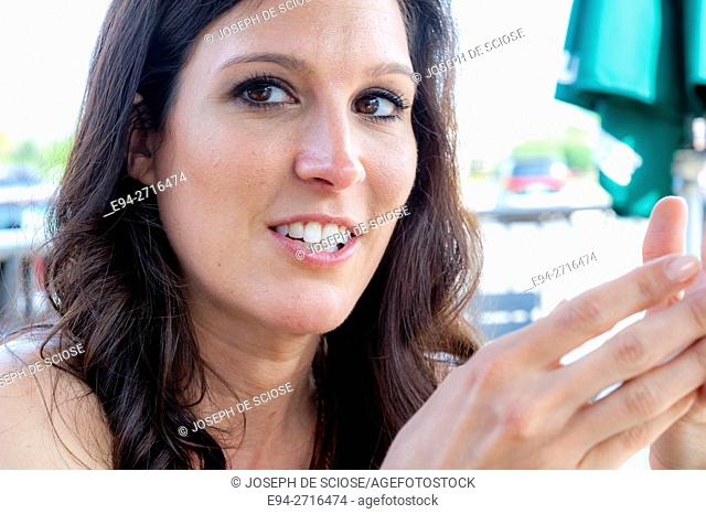 A pretty brunette woman smiling at the camera