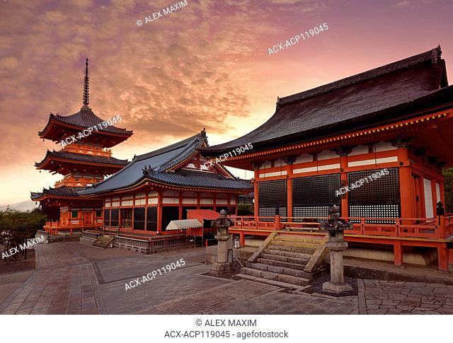 Kiyomizu-dera Buddhist temple, Sanjunoto pagoda, Kaisan-do and Kyo-do hall. Beautiful sunrise scenery with dramatic red sky. Kyoto, Japan 2017