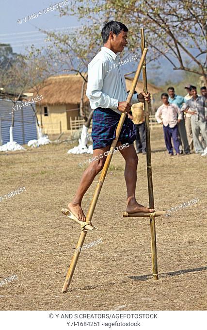 Tribes playing bamboo stilts game at Namdapha Eco Cultural Festival, Miao, Arunachal Pradesh, India