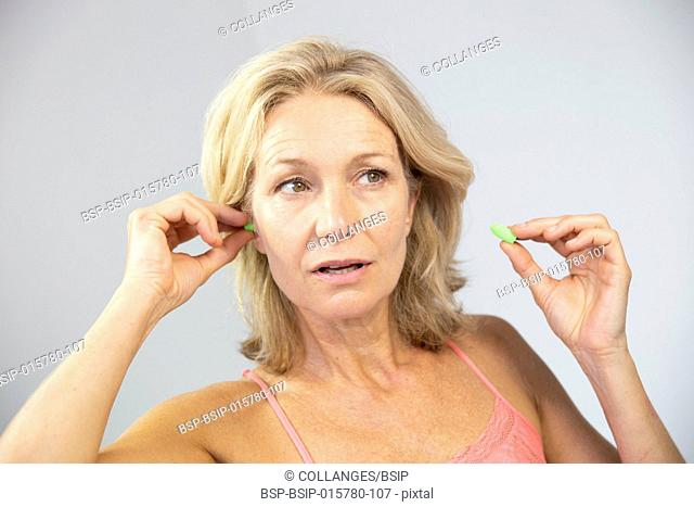 Woman using earplugs
