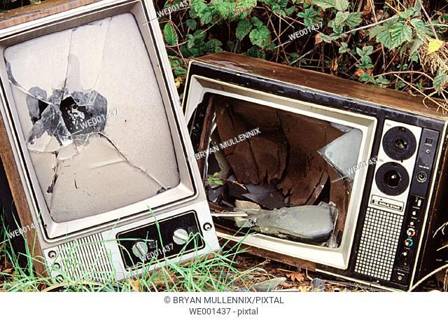 Broken televisions dumped in field