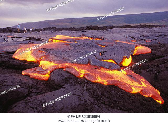 Hawaii, Big Island, Hawaii Volcanoes National Park, Chain of Craters Road, pahoehoe lava flow glowing, twilight