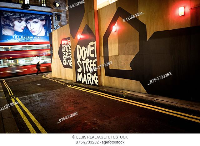 "Street corner with bus in blurred motion, pedestrian and film poster of ""The Danish Girl"". Haymarket, London, England"