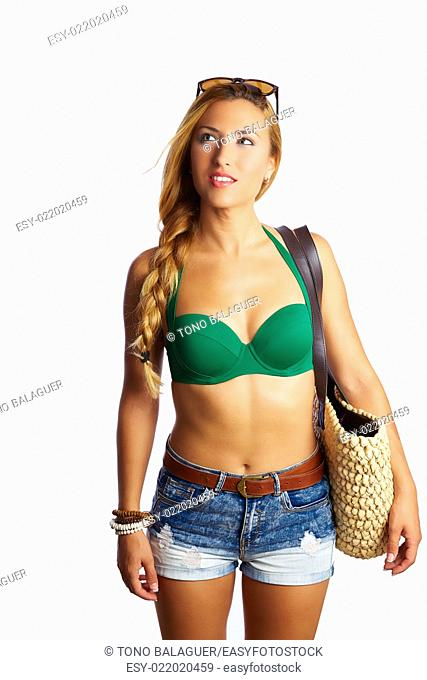 blond short jeans sexy tourist woman going beach with basket bag and sungrlasses on hair