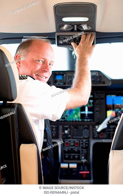 Pilot smiling in airplane cockpit