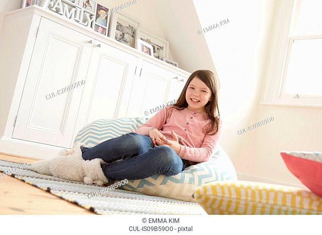 Portrait of girl reclining on beanbag chair