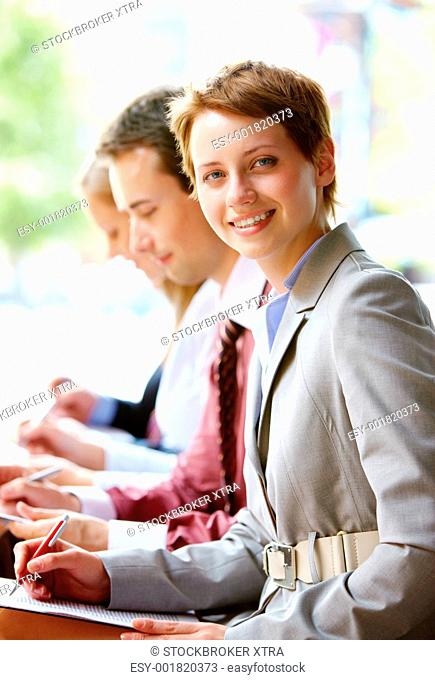 Group of happy successful people in line with focus on woman