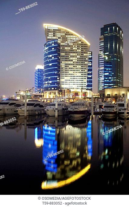 Festival city with marina harbour at dusk , Dubai, United Arabian Emirates